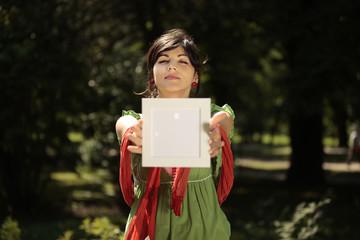 beautiful girl holding a whiteboard
