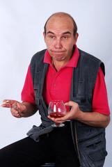 Surprised Senior Man With A Cognac Glass