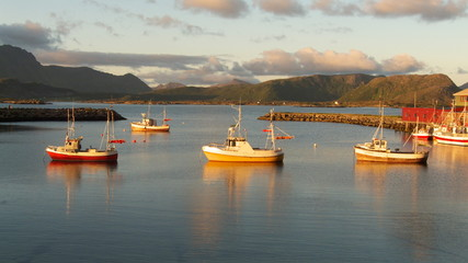 three fishing boats in Eggum at  midnight