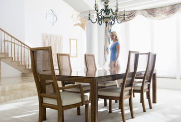 Woman in dining room smiling