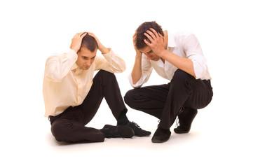 two sad businessmen