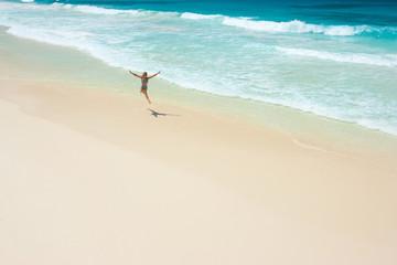 jump on deserted beach