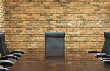 conference room with brick wall