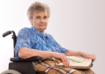 portrait of an elderly woman in wheelchair