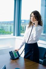 Businesswoman calling on phone
