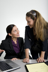 brunette women working in business suit at office
