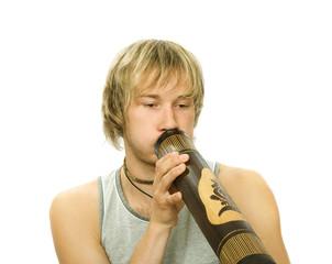 Guy's playing  didgeridoo