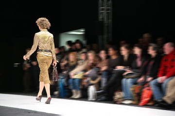 fashion model on podium from back