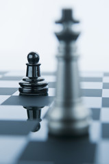 Pawn Facing King Chess Piece.