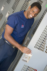 Portrait of a firefighter in the fire station locker room