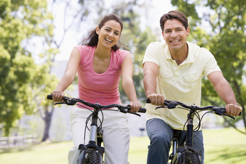 Wall Murals Cycling Couple on bikes outdoors smiling