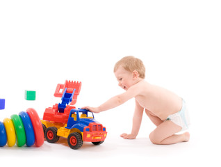 Little boys play with toy truck