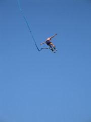 Bungee jumper high in the sky