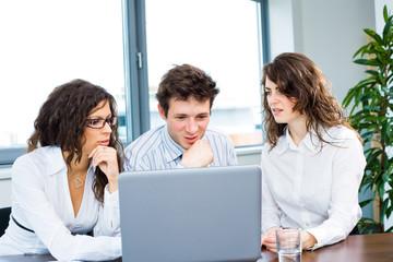 Businessteam working on laptop