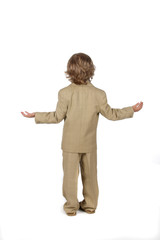 young boy in suit with arms out