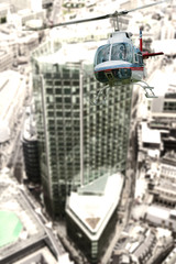 Helicopter over city buildings