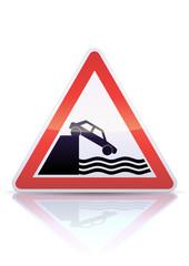 Panneau de danger débouché sur un quai (reflet métal)