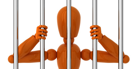 Orange mannequin to be behind bars.