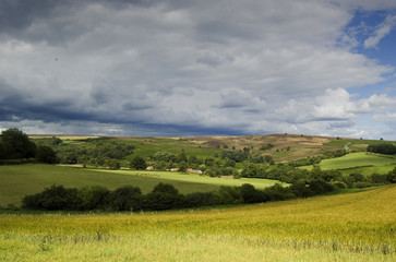 Poster Hill Storm Clouds over the Moors