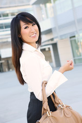 A young beautiful asian business woman at office