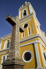 Stone cross next to cathedral in central Granada Nicaragua