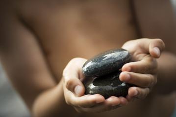 Child holding pebbles