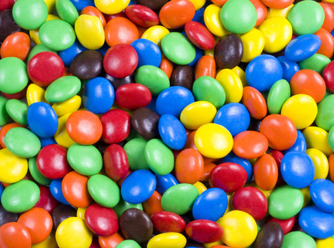 Assortment of Colorful Chocolate Candy Usable as Background