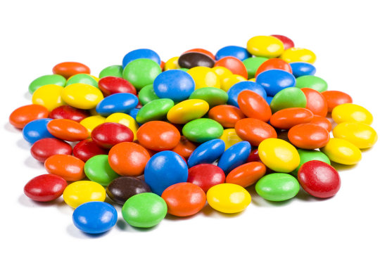 Assortment of Colorful Chocolate Candy on White Background