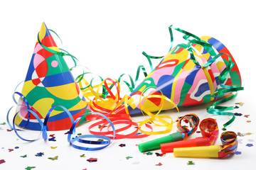 Party hats, paper streamer and  whistles