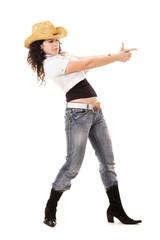 beautiful cowgirl holding her hands like gun