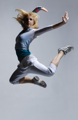 stylish and cool looking breakdancer jumping