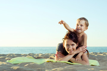 Mother with son on the beach.