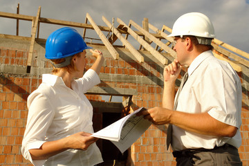 Female investor discussing building plans with site manager
