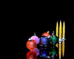 christmas tree ornaments balls and candles on black