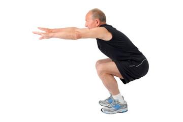 Fit senior man doing a squat