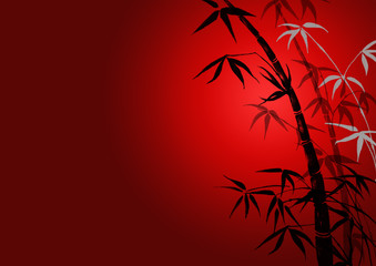 bamboo leaves on ared background.