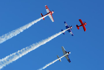 Stunt aircraft in formation, blue sky at air show performance
