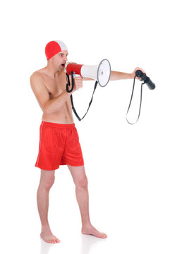 Young handsome lifeguard with megaphone and binoculars.