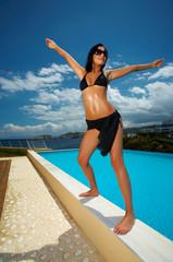 Beautiful young Sexy woman standing in black bikini