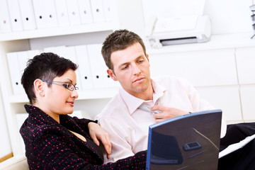 Business partners teamworking at office, sitting on sofa