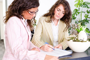 Casual businesswomen working in team at office reception
