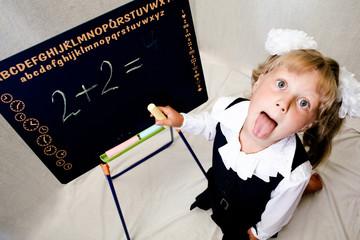 An image of nice little girl near blackboard.