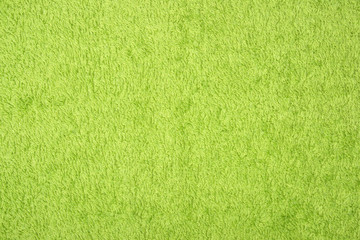 A photo of green relief textile smooth texture