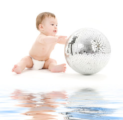 picture of adorable baby boy with big disco ball