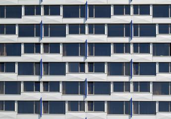Row of equal windows of modern building