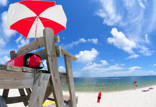 Lifeguard stand and umbrella at beach