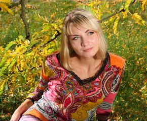 beautiful blond girl under yellow three