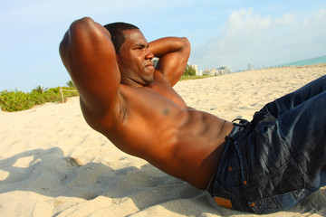 Doing situps on the beach