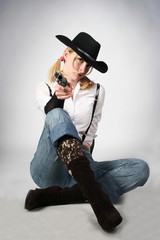 sexy cowgirl with old-fashioned gun