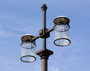 Modern street lantern on a background of the sky